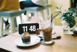 Clock on table next to coffee